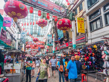 People walk through a busy China town at Petaling Street, Malays Royalty Free Stock Image