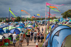 People Walk Through Camping Area at Glastonbury Festival 2014 royalty free stock images