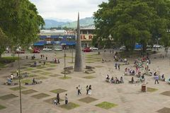 People walk by the Central square in Carago, Costa Rica. Royalty Free Stock Photo