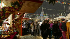 People walk on the Christmas Fair in Moscow stock footage