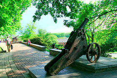 People walk in the city park with old cannons in Chernihiv Royalty Free Stock Photo