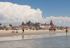 People walk on Coronado beach, San Diego, California Stock Photo