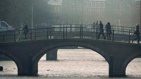 People Walk And Cycle Over Bridge stock footage
