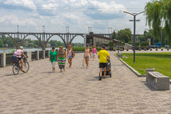 People walk on the Dnepr river embankment at summer weekend. Dnepropetrovsk, Ukraine - July 10, 2016: People walk on the Dnepr river embankment at summer weekend stock images