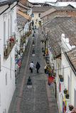 People walk down the famous street known as Calle La Ronda in Quito in Ecuador. At an elevation of 2850 metres above sea level, Quito is the highest capital Stock Images