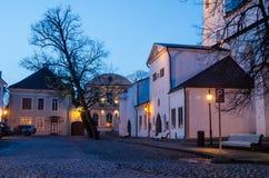People walk down the street of Old Tallinn Royalty Free Stock Image