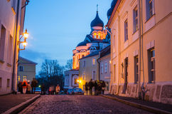 People walk down the street of Old Tallinn Stock Images