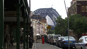 People walk down street in Sydney towards bridge stock video