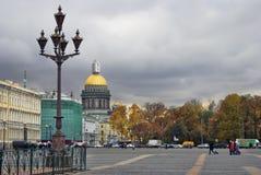 Architecture of Saint-Petersburg, Russia. People walk on Dvortsovaya Square Stock Image