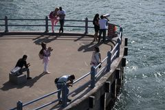 People walk on the embankment in good weather Stock Photo