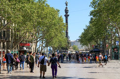 People walk by at the famous La Rambla, Barcelona, Spain Royalty Free Stock Photo