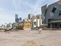 People walk at Federation Square in Melbourne Royalty Free Stock Image