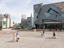 People walk at Federation Square, Melbourne Royalty Free Stock Photo