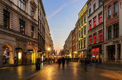 People walk by Florianska street in Krakow Stock Images