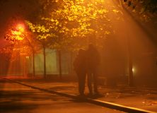 People walk in fog and light Royalty Free Stock Image