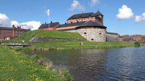 People walk at the fortress Hameenlinna on a sunny june day. Finland stock footage