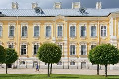 People walk in front of the Rundale palace facade  in Pilsrundale, Latvia. Stock Photography