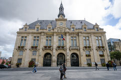 People walk in front of the Saint-Denis city hall. SAINT-DENIS, FRANCE SEPTEMBER 14, 2015 People are walking in front of the City Hall of Saint-Denis, which Royalty Free Stock Photos