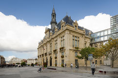 People walk in front of the Saint-Denis city hall. SAINT-DENIS, FRANCE SEPTEMBER 14, 2015 People are walking in front of the City Hall of Saint-Denis, which Royalty Free Stock Photo