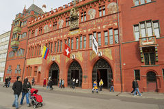 People walk in front of the Town Hall in Basel, Switzerland. Royalty Free Stock Image