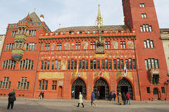 People walk in front of the Town Hall buylding in Basel, Switzerland. Stock Photography