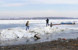 People walk on the frozen Danube river Stock Photo