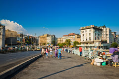 People walk daily by Galata Bridge on August 24, 2013 in Istanbu Stock Photo