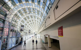People walk through the glass indoor walkway between Union Stati Royalty Free Stock Photos