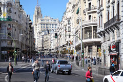 People walk on Gran Via Royalty Free Stock Photos