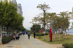 People walk in haicang bay park Stock Photo