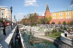 People walk in holiday in Alexander Garden in Moscow Stock Images