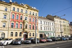 People walk in hotel classical building and car parking. Beside road at new town on August 30, 2017 in Prague, Czech Republic Royalty Free Stock Photos