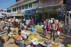 People walk by the local market in Bandarban, Bangladesh. Stock Image