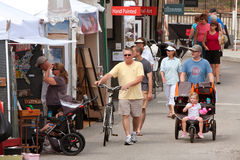 People Walk, Look And Shop At Summer Arts Festival Royalty Free Stock Images