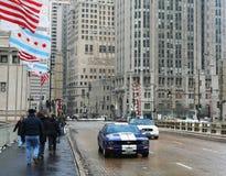 People walk on Michigan avenue bridge in Chicago Stock Image