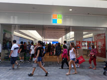 People walk by Microsoft Windows Store on Black Friday Royalty Free Stock Photography