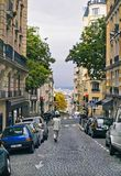 People walk on the Montmartre district in Paris, France. Royalty Free Stock Photo