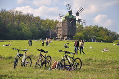 People walk, nature, old mill, a bikes in foreground Royalty Free Stock Photography