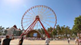 People walk near the ferris wheel, a large modern ferris ring. Observation Wheels.  stock footage