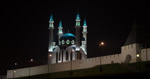 People walk at night near the mosque stock footage