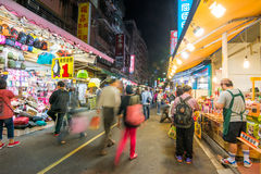 People walk on old streets at night in Tamsui Royalty Free Stock Photography