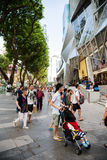 People walk the Orchard Road in Singapore Stock Photos