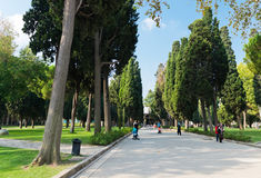 People walk in park in the Topkapi Palace on August 25, 2013 in Stock Image