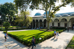 People walk in park in the Topkapi Palace on August 25, 2013 in Stock Images
