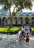 People walk in park in the Topkapi Palace on August 25, 2013 in Royalty Free Stock Photography