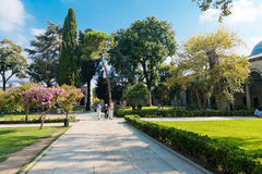 People walk in park in the Topkapi Palace on August 25, 2013 in Stock Photography