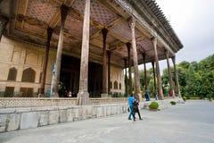 People walk past the 17 century Hasht-Behesht Palace, Iran Royalty Free Stock Images