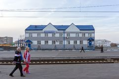 People walk past the office of a large Russian federal state company Russian Post at a railway station in the Siberian city. BARABINSK / NOVOSIBIRSK REGION / RF stock images