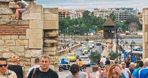 People walk through pedestrian cobblestone streets of ancient Nessebar stock video footage