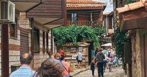 People walk through pedestrian cobblestone streets of ancient Nessebar stock video